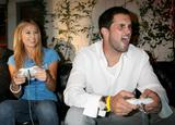Stacy Keibler - Playing XBOX 360's Madden NFL '08 at the VIP Premiere of the Game, June 28 2007